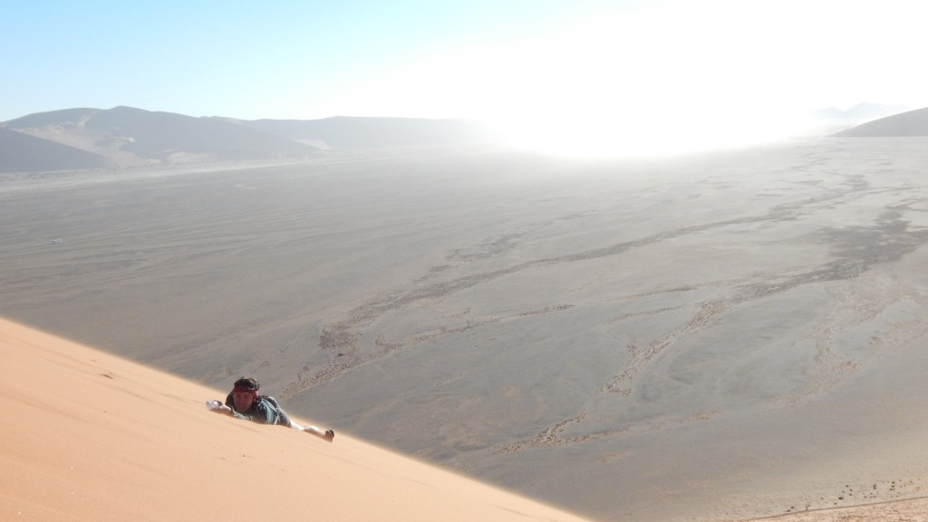 Lis takes a break to spit up sand after rolling down Dune 45