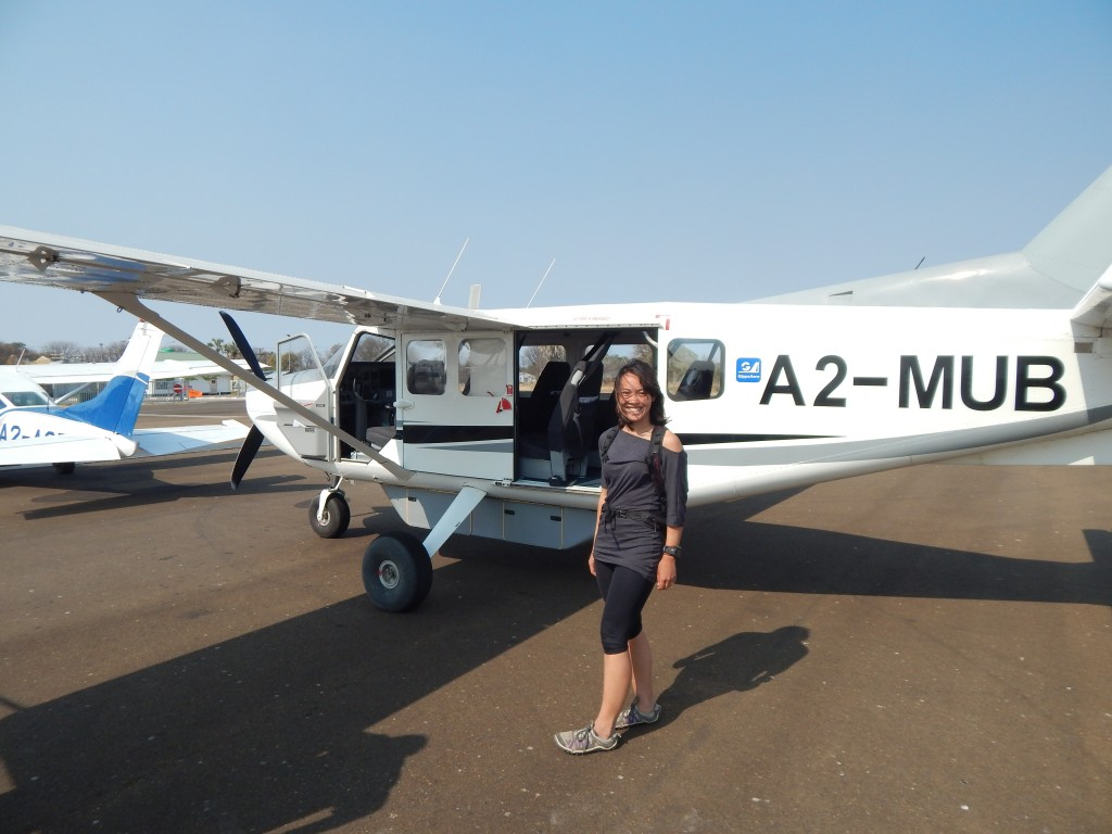 Lis in front of the plane for our scenic flight