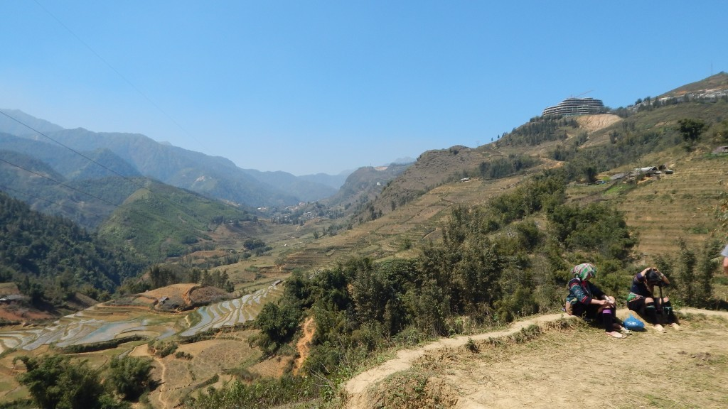 Two Black Hmong women looking out onto Sapa's rice terraces